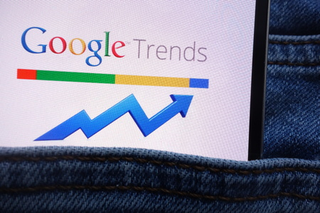 KONSKIE, POLAND - JUNE 11, 2018: Google Trends logo displayed on smartphone hidden in jeans pocket