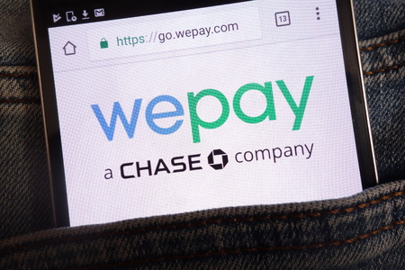 KONSKIE, POLAND - JUNE 11, 2018: Wepay website displayed on smartphone hidden in jeans pocket