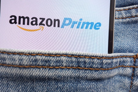 KONSKIE, POLAND - JUNE 12, 2018: Amazon Prime logo displayed on smartphone hidden in jeans pocket 에디토리얼