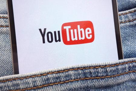 KONSKIE, POLAND - JUNE 12, 2018: YouTube logo displayed on smartphone hidden in jeans pocket