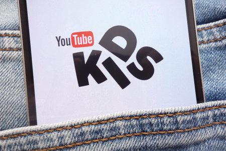 KONSKIE, POLAND - JUNE 12, 2018: YouTube Kids logo displayed on smartphone hidden in jeans pocket Editorial