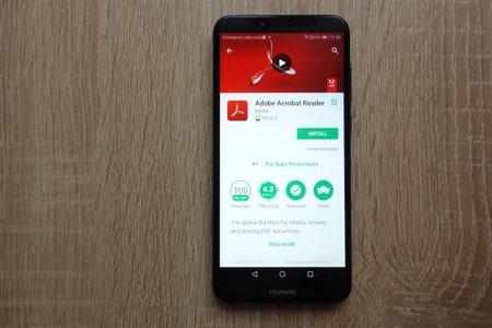 KONSKIE, POLAND - JUNE 17, 2018: Adobe Acrobat Reader app on Google Play Store displayed on Huawei smartphone