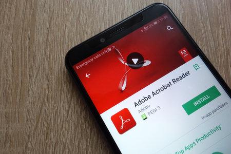 KONSKIE, POLAND - JUNE 17, 2018: Adobe Acrobat Reader app on Google Play Store displayed on a modern smartphone