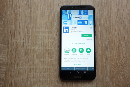 KONSKIE, POLAND - JUNE 17, 2018: LinkedIn app on Google Play Store website displayed on Huawei Y6 2018 smartphone Editorial