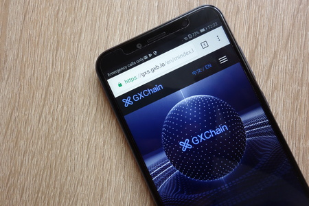 KONSKIE, POLAND - JULY 01, 2018: GXChain (GXS) cryptocurrency website is displayed on Huawei Y6 2018 smartphone