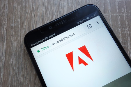 KONSKIE, POLAND - JULY 21, 2018: Adobe company website displayed on a modern smartphone