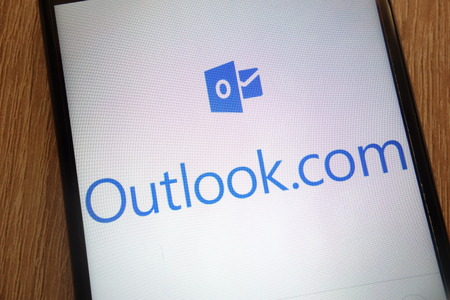 KONSKIE, POLAND - SEPTEMBER 01, 2018: Outlook.com logo displayed on a modern smartphone