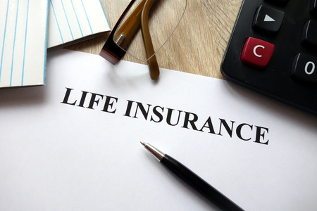 Life insurance document with pen, calculator and glasses on desk Imagens - 115252124