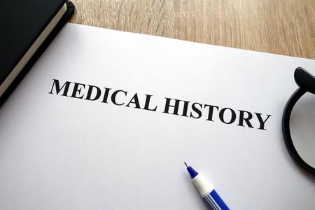 Medical history document, pen and glasses on desk Stockfoto - 115244393