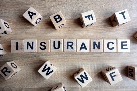 Insurance word from wooden blocks on desk