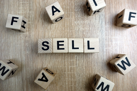 Sell word from wooden blocks on desk