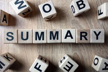 Summary word from wooden blocks on desk 版權商用圖片
