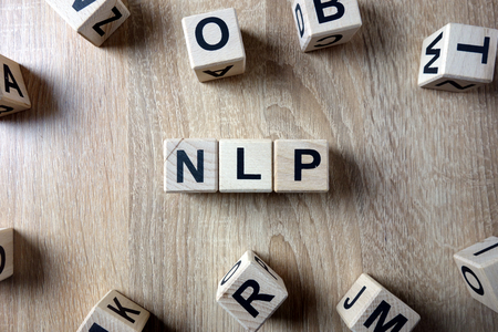 NLP word from wooden blocks on desk