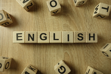 English word from wooden blocks on desk Banco de Imagens