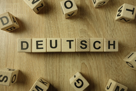 Deutsch word from wooden blocks on desk