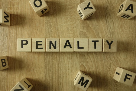 Penalty word from wooden blocks on desk