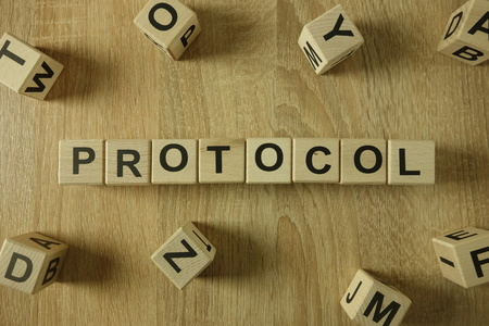 Protocol word from wooden blocks on desk