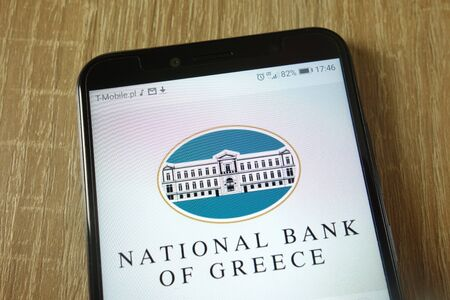 KONSKIE, POLAND - February 22, 2019: National Bank of Greece logo displayed on smartphone 報道画像