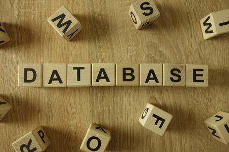 Database word from wooden blocks on desk