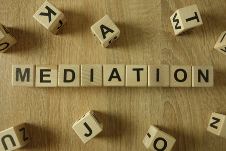 Mediation word from wooden blocks on desk