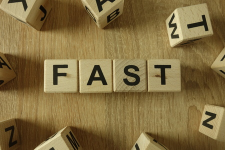 Fast word from wooden blocks on desk
