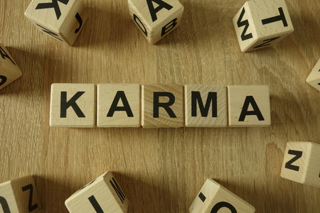 Karma word from wooden blocks on desk 免版税图像
