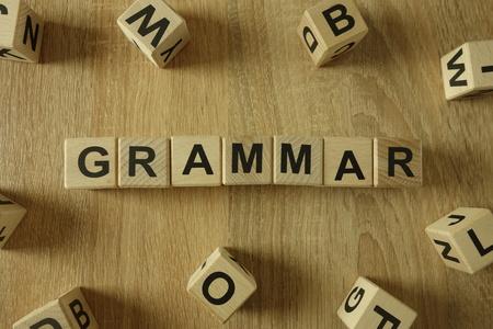 Grammar word from wooden blocks on desk