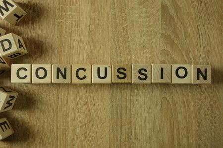 Concussion word from wooden blocks on desk