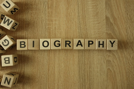 Biography word from wooden blocks on desk Imagens