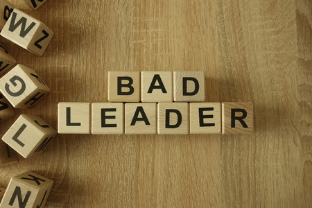 Bad leader text from wooden blocks on desk Stok Fotoğraf