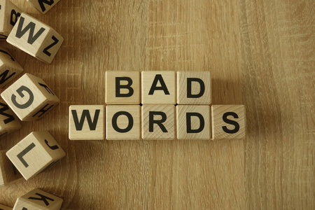 Bad words text from wooden blocks on desk Stok Fotoğraf