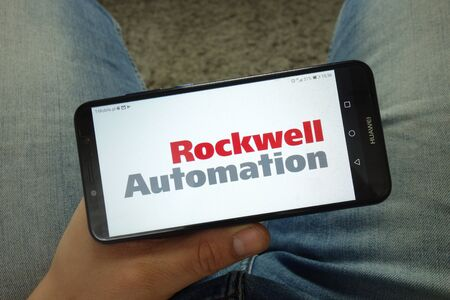 KONSKIE, POLAND - April 13, 2019: Man holding smartphone with Rockwell Automation logo