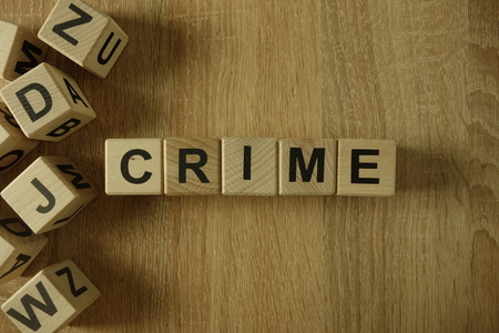 Crime word from wooden blocks on desk