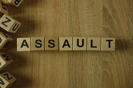 Assault word from wooden blocks on desk Stock Photo