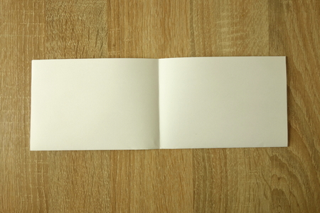 Blank booklet on wooden background Stock fotó