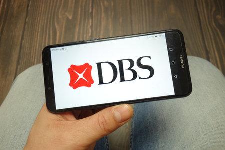 KONSKIE, POLAND - 05 MAY, 2019: DBS Bank logo displayed on Huawei smartphone Редакционное