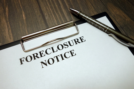 Clipboard with foreclosure notice mockup and pen on wooden desk background