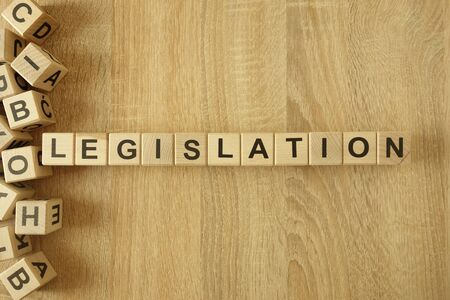 Word legislation from wooden blocks on desk background Stock Photo