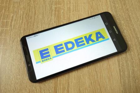 KONSKIE, POLAND - June 21, 2019: Edeka Group company logo displayed on mobile phone Redakční