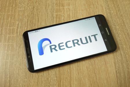 KONSKIE, POLAND - June 21, 2019: Recruit Holdings Co Ltd company logo displayed on mobile phone Redakční