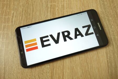 KONSKIE, POLAND - June 21, 2019: Evraz plc company logo displayed on mobile phone