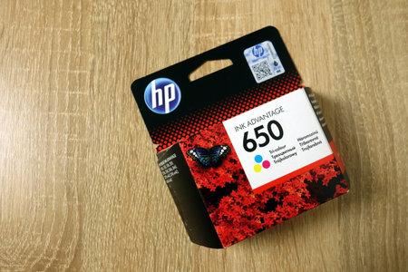 KONSKIE, POLAND - June 21, 2019: HP Ink Advantage 650 for printer on wooden desk