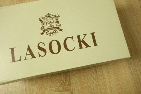 KONSKIE, POLAND - June 21, 2019: Lasocki shoes in packaging on wood