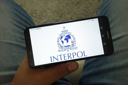 KONSKIE, POLAND - June 29, 2019: Interpol organization logo displayed on mobile phone Reklamní fotografie - 127812856