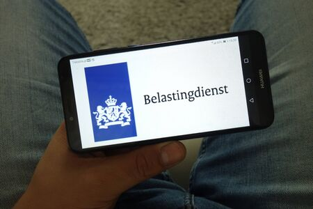 KONSKIE, POLAND - June 29, 2019: Belastingdienst - Dutch Tax and Customs Administration logo displayed on mobile phone