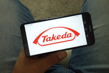 KONSKIE, POLAND - June 29, 2019: Takeda Pharmaceutical Company Ltd logo displayed on mobile phone Reklamní fotografie - 127812901