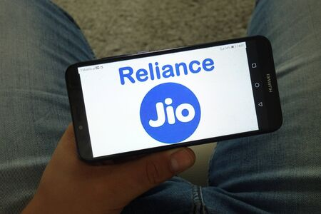 KONSKIE, POLAND - June 29, 2019: Reliance Jio Infocomm Limited Indian mobile network operator logo displayed on mobile phone