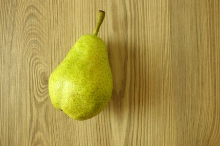 Fresh ripe organic pear on rustic wooden table background