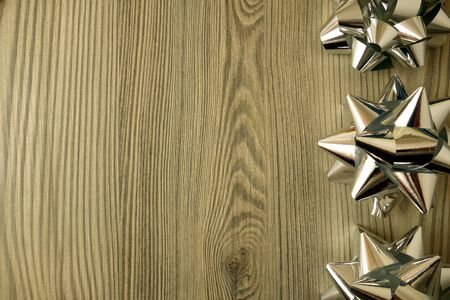 Shiny silver ornaments on rustic wooden background, copy space for your design Banco de Imagens