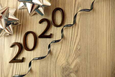 2020 Happy New Year background with decoration on rustic wood